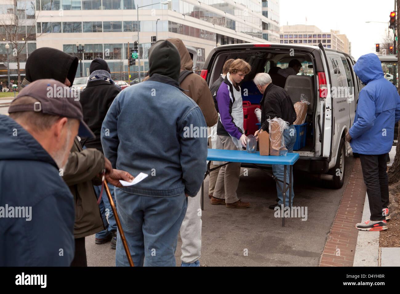 Homeless Men Standing In Line For Soup Kitchen Van   Washington, DC USA    Stock