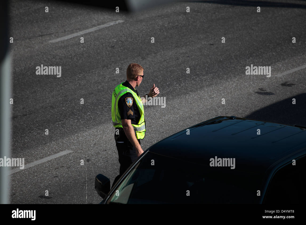 Police officer directing traffic. - Stock Image