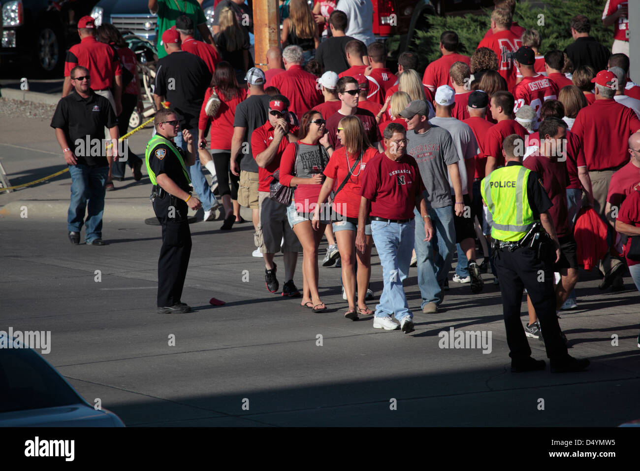 Police officers direct thick Nebraska Cornhuskers pedestrian traffic. Stock Photo