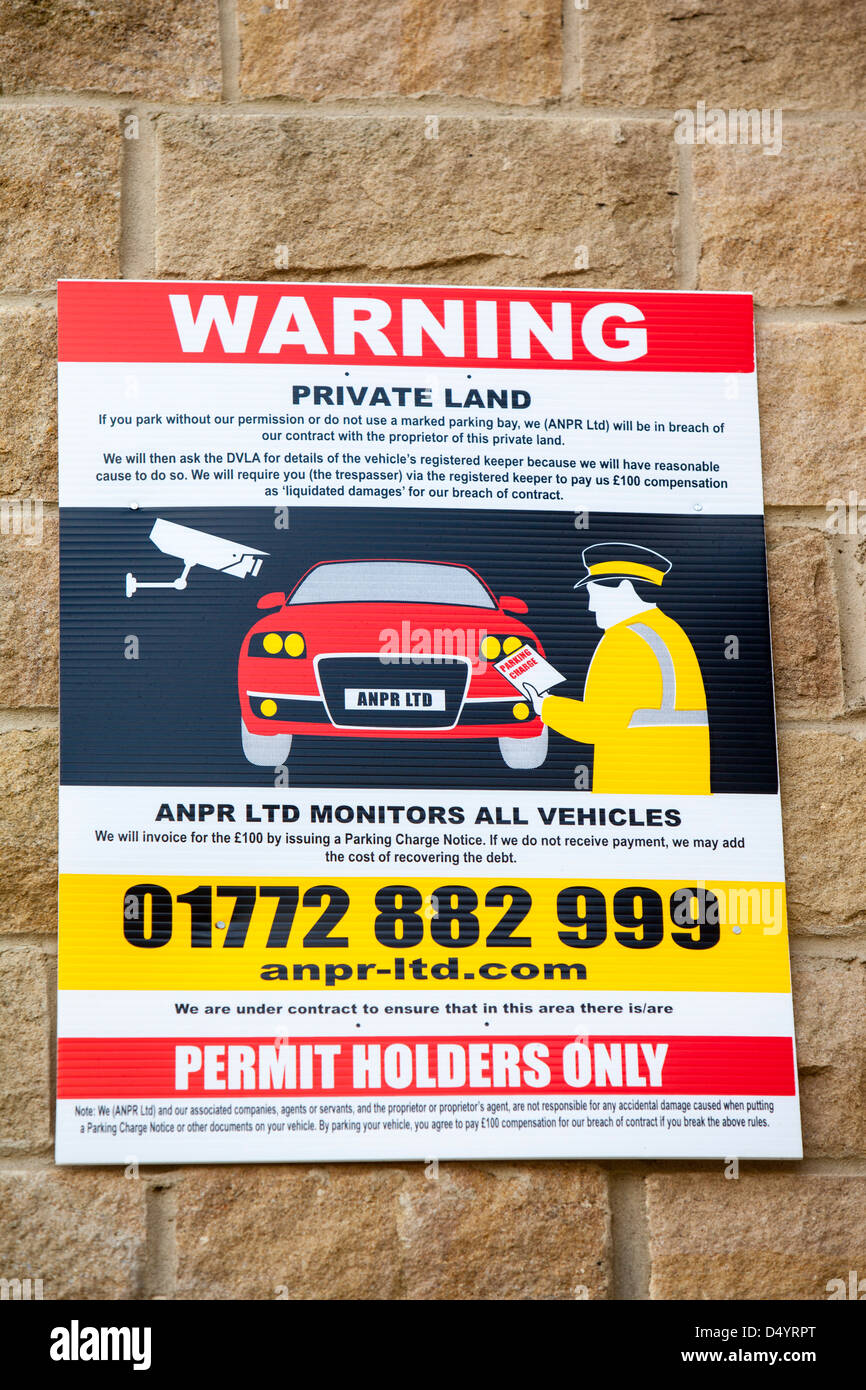A wheel clamping warning sign on private land in Bingley, Yorkshire, UK. - Stock Image