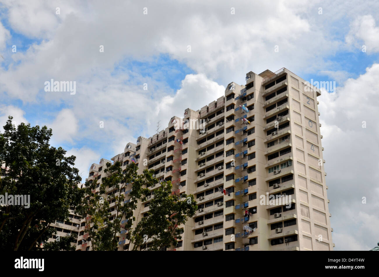 Apartment building clear blue sky - Stock Image