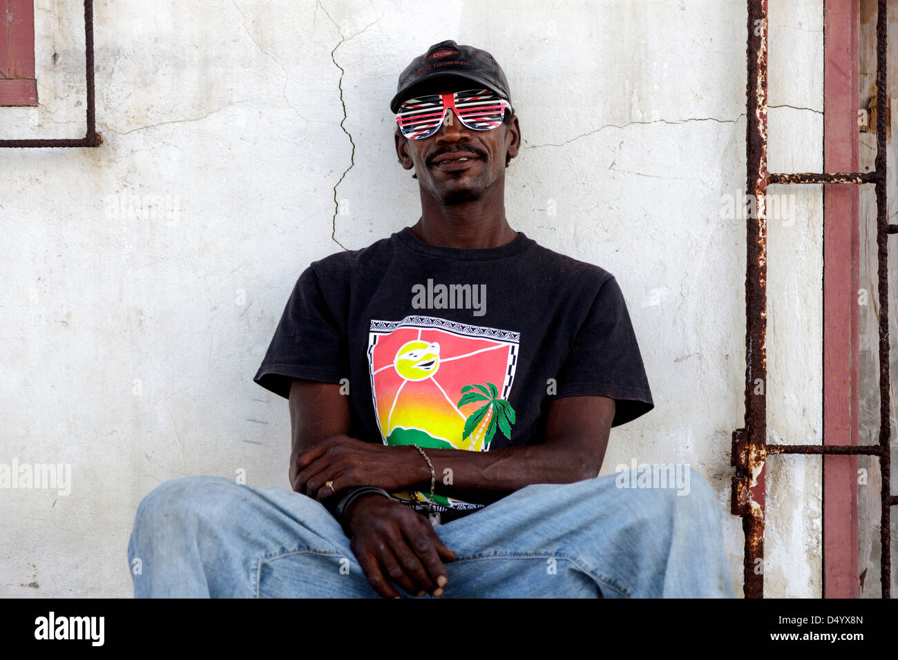 Local man from Micoud village, wearing Union Jack sunglasses, St Lucia - Stock Image