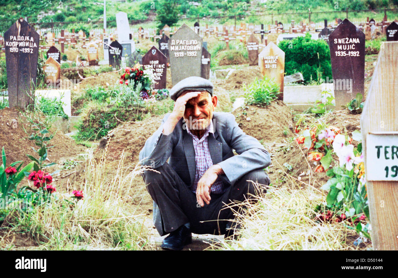 Naim Pasic mourns the loss of his wife and daughter at Lion cemetary in Sarajevo, Bosnia, on Wednesday, June 2, Stock Photo