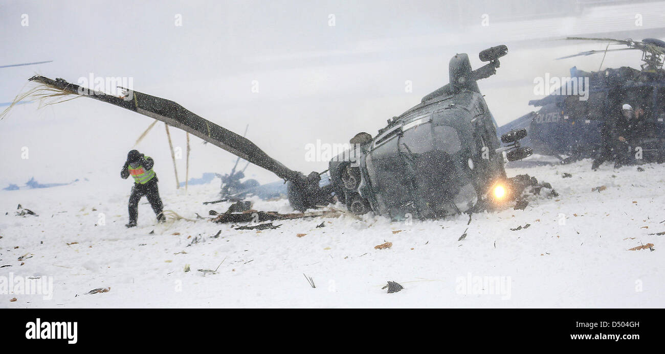 Two crashed helicopters of the German federal police lie on the May field at the Olympic Stadium in Berlin, Germany, - Stock Image