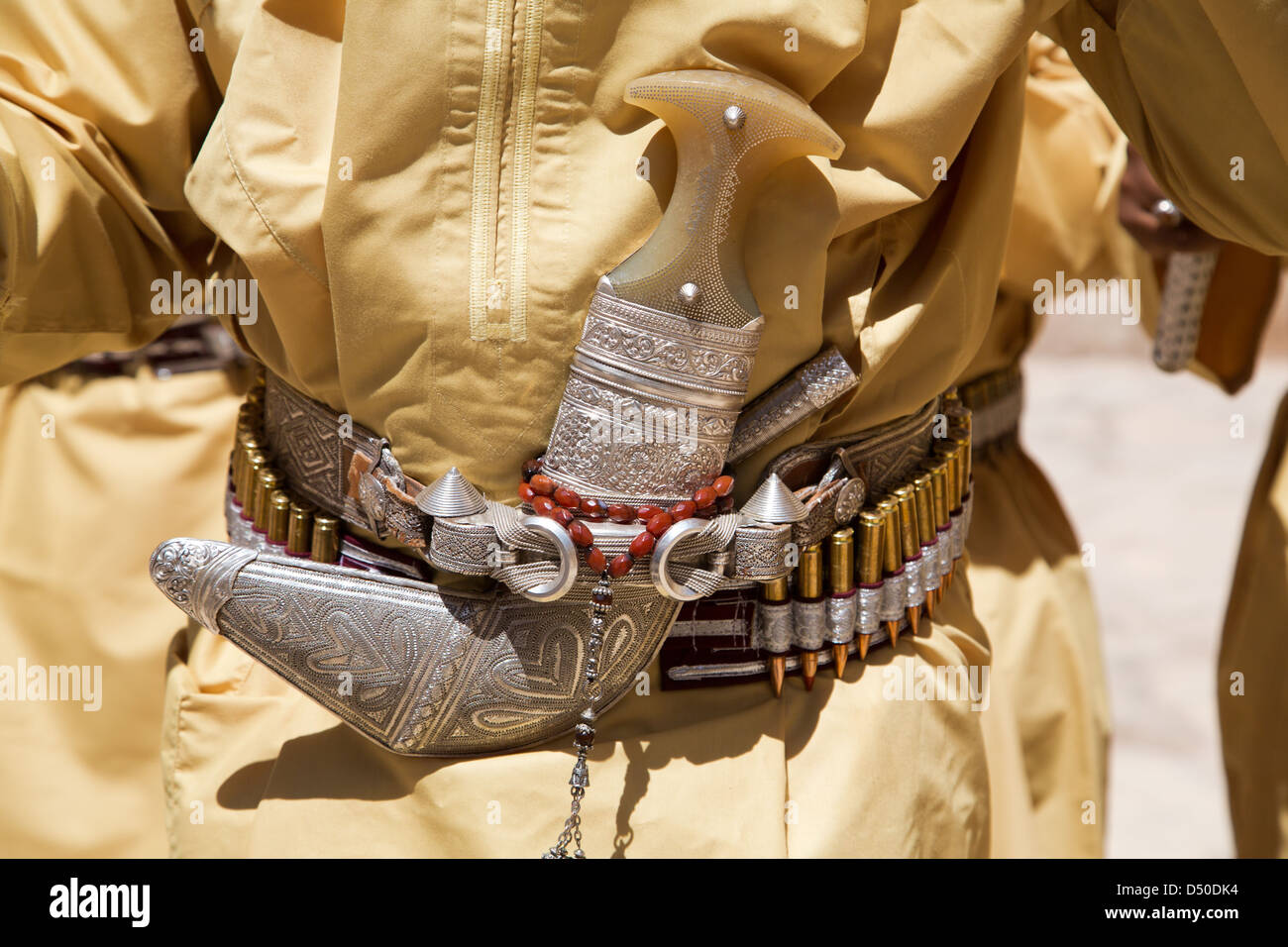 Traditional Omani Khanjar dagger worn in a sheath on a belt lined with bullets - Stock Image