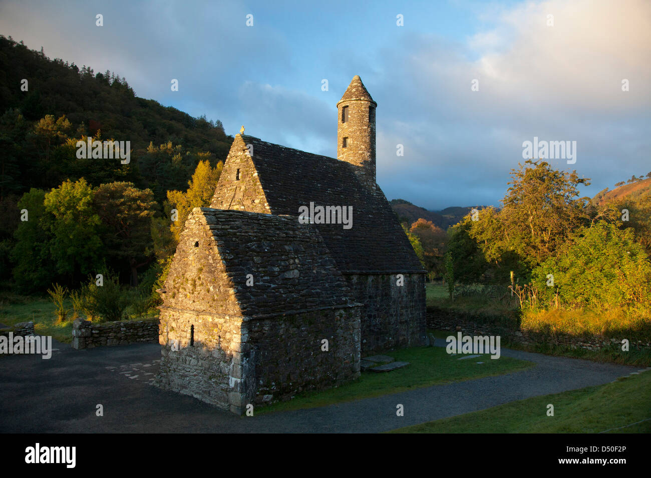 St Kevin's church and round tower, Glendalough monastic site, Co Wicklow, Ireland. - Stock Image
