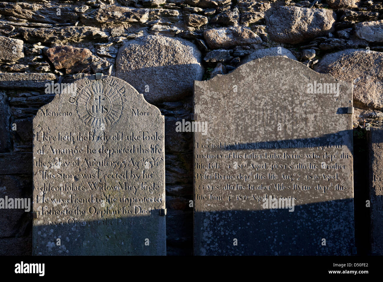 18th century gravestones beside St Kevin's church, Glendalough monastic site, County Wicklow, Ireland. - Stock Image