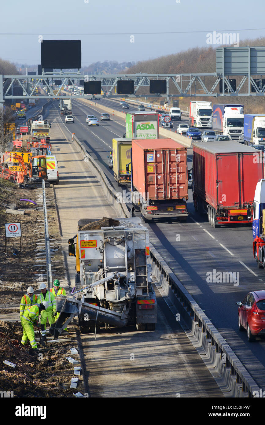 lorry delivering cement to construction workers working on M62 upgrade Leeds, Yorkshire, United Kingdom Stock Photo