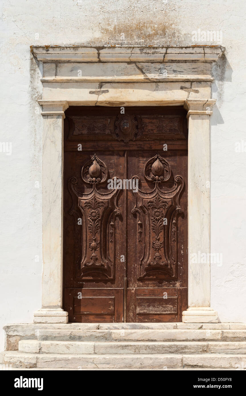 Wooden door of a church decorated with floral motifs, Portel, Portugal - Stock Image