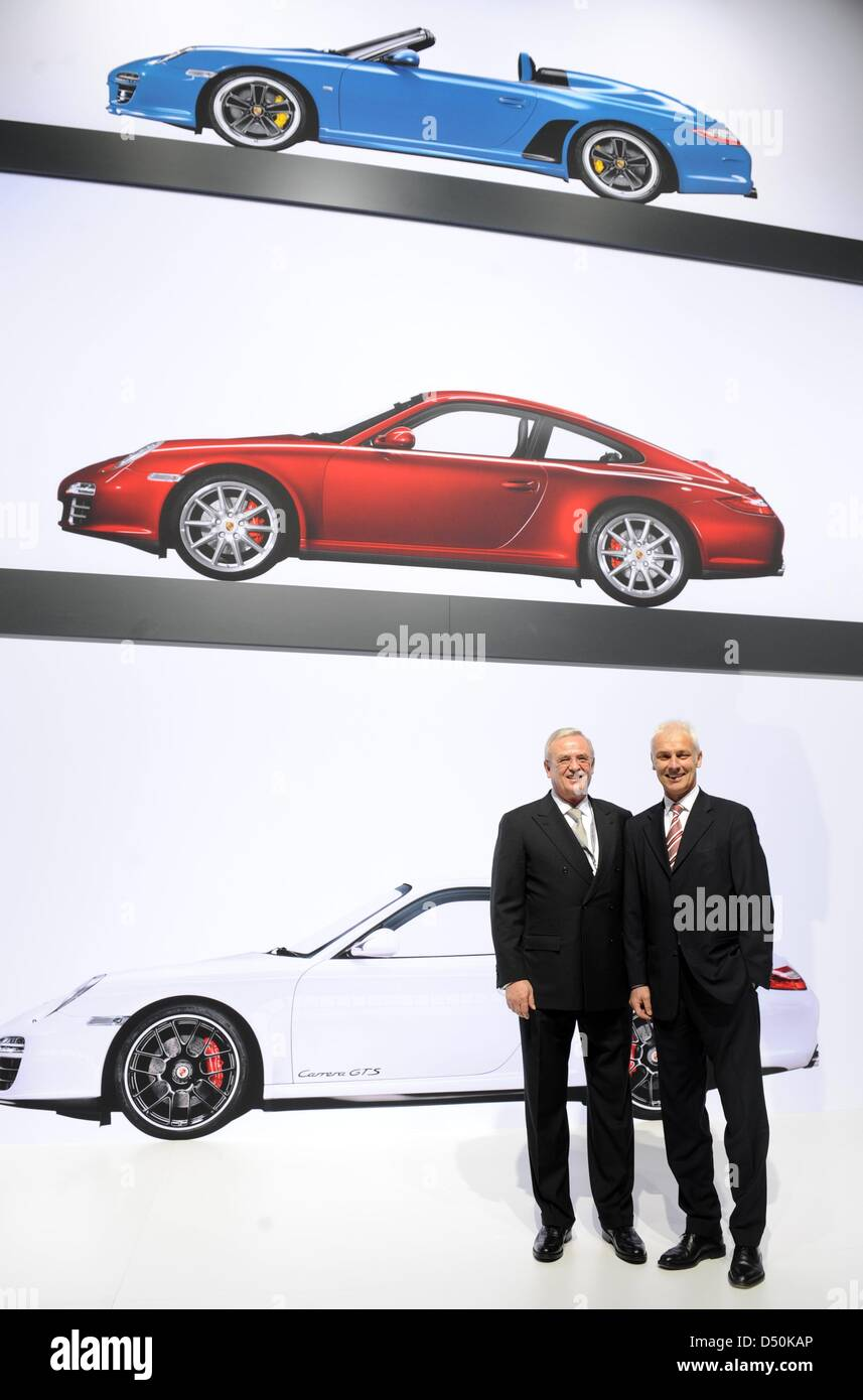 Martin Winterkorn (L), chairman of the board of directors of Porsche Automobil Holding SE stands together with Porsche Stock Photo