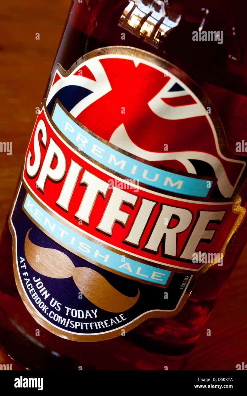 Close up view of Spitfire brand beer label on a bottle of real ale made by Kentish brewer Shepherd Neame for the - Stock Image
