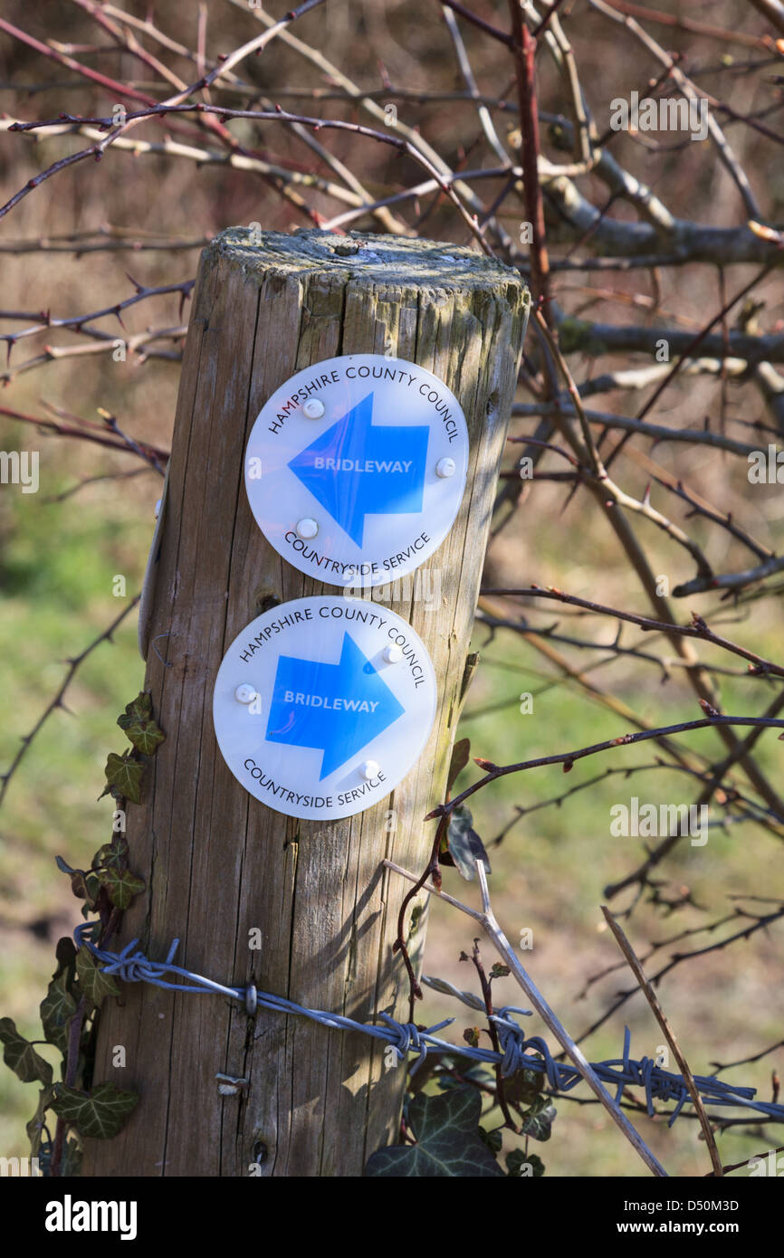 A bridleway sign on a post along Hollowshot Lane (Track) near Kingsclere in Hampshire - Stock Image