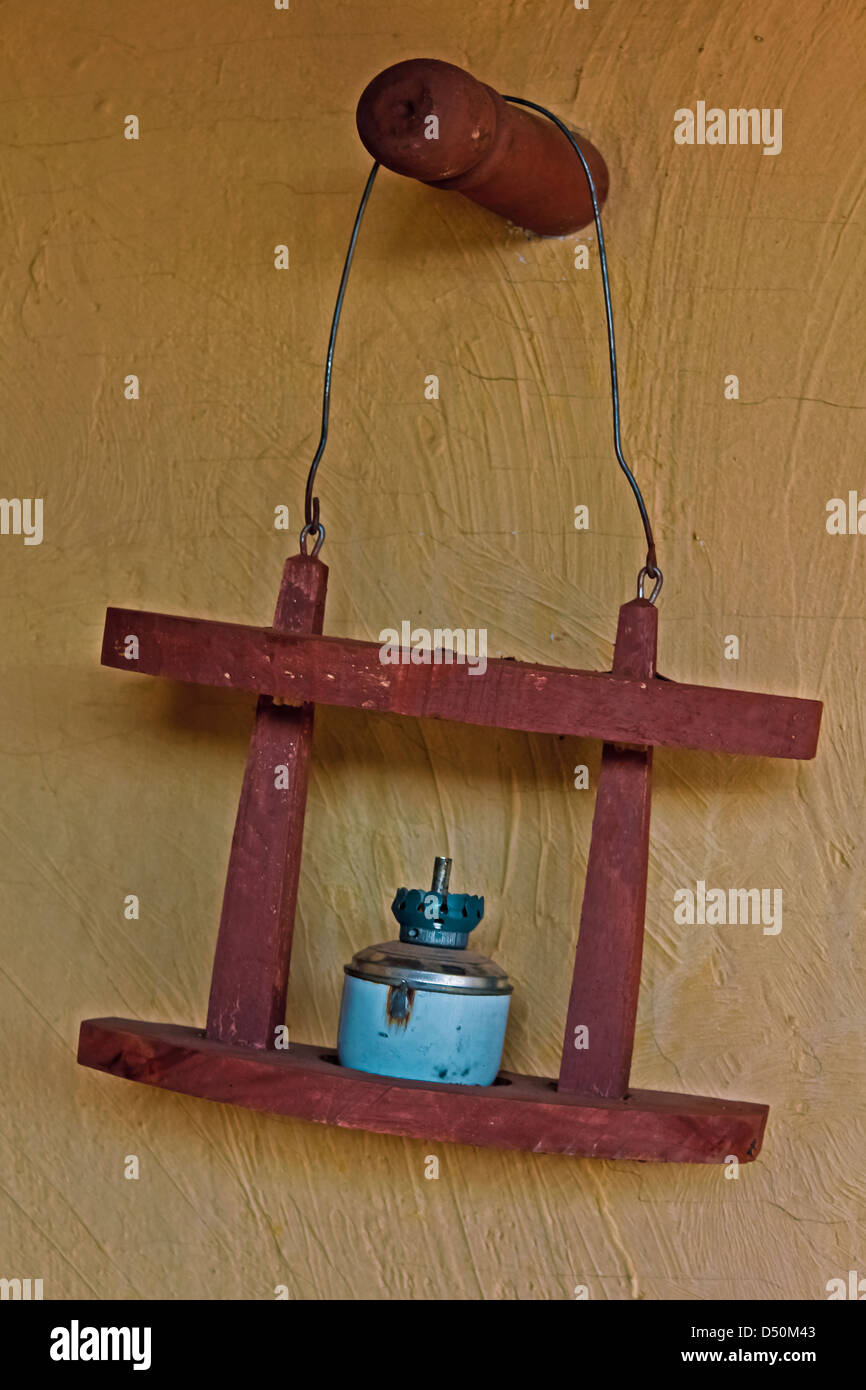 Old Oil Lamp in a Wooden Stand, Hanging, India - Stock Image