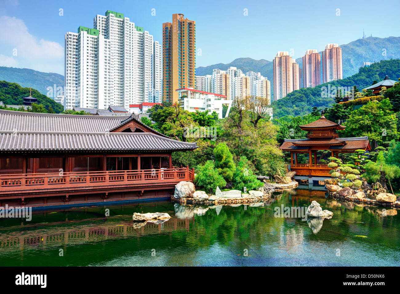Pond and cityscape viewed from Nan Lian Garden in Hong Kong, China. - Stock Image