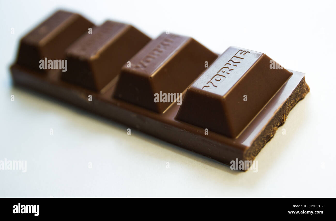 Close up of a Yorkie Bar with one piece missing - Stock Image