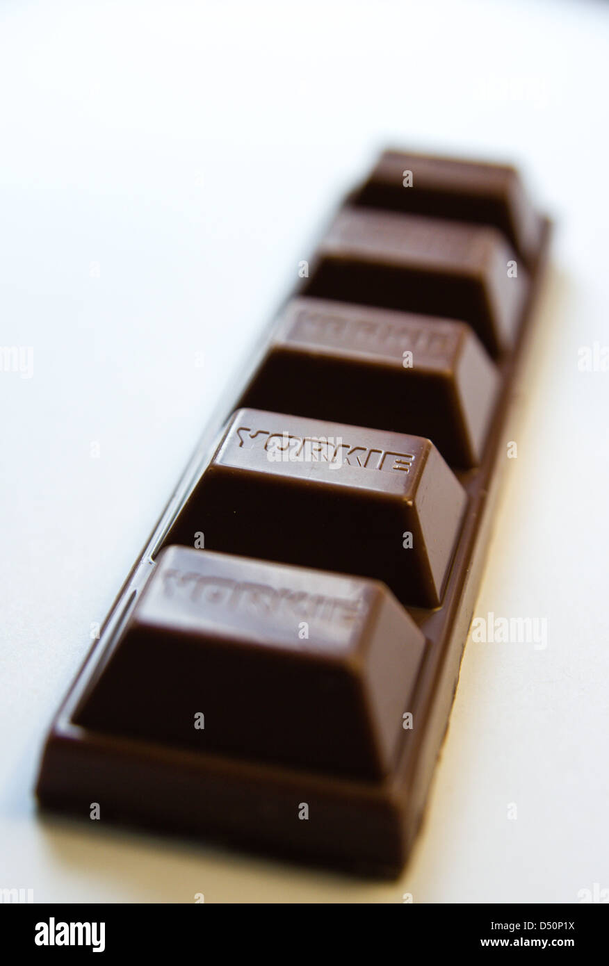 A close up of a freshly unwrapped chocolate bar - Stock Image