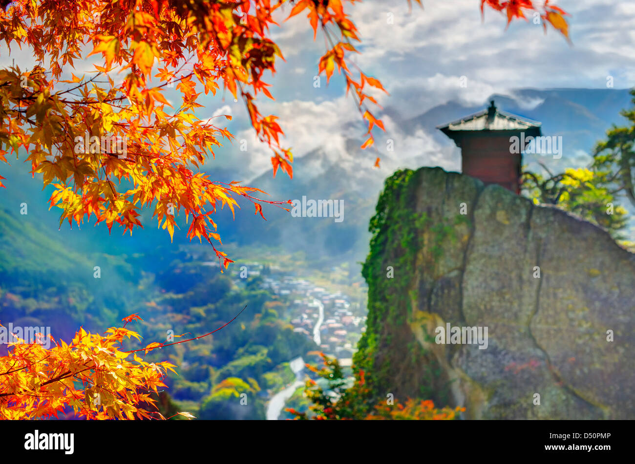 Yamadera is a mountain temple. selective focus on foreground fall leaves. - Stock Image