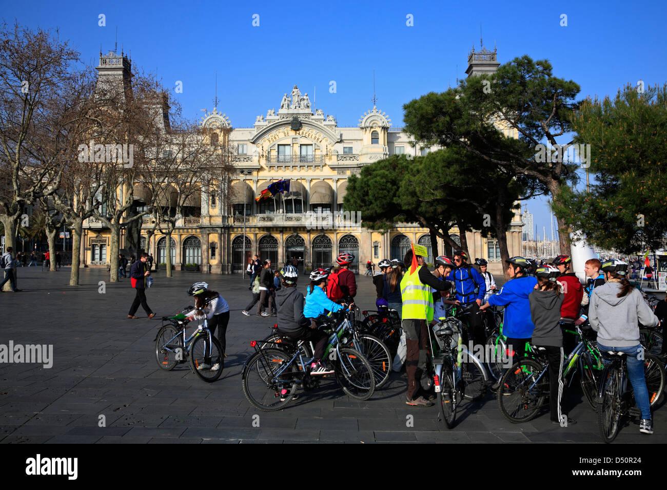 Guided bicycle tour at Placa del Portal de la Pau at harbor, Barcelona, Spain Stock Photo