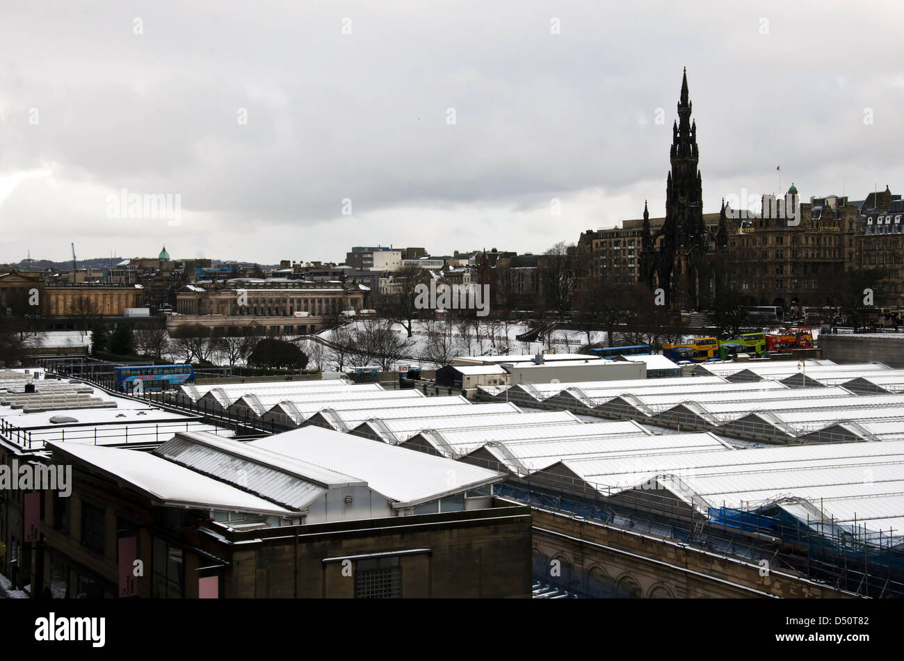 Edinburgh in the snow: looking over the roof of the snow-covered Waverley Station towards Princes Street. - Stock Image