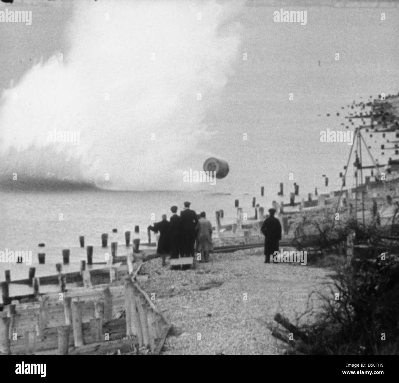 Movie still, showing an inert, practice version of the Upkeep bouncing bomb being dropped during a training flight - Stock Image