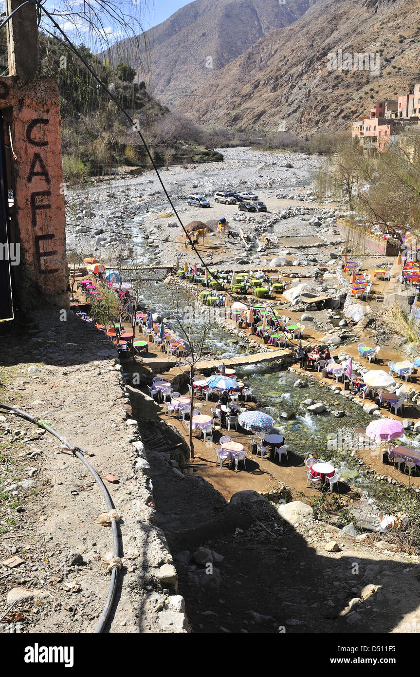 Looking down at cafes lining the riverside of the popular Setti Fatma near Cascades Ourika Setti Fatma , Ourika Valley ,Morocco Stock Photo