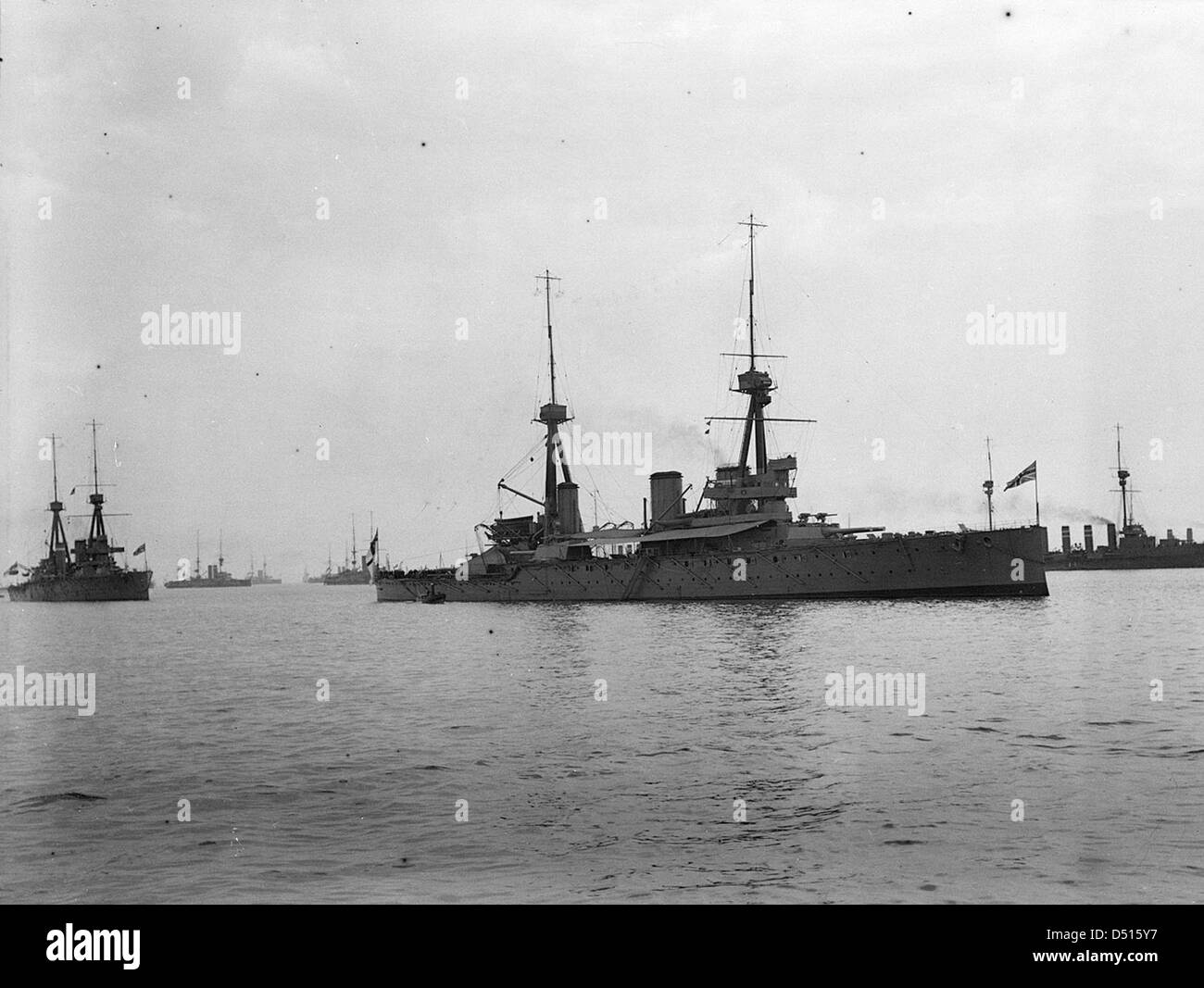 HMS 'Inflexible' anchored at Spithead for the Naval Review - Stock Image