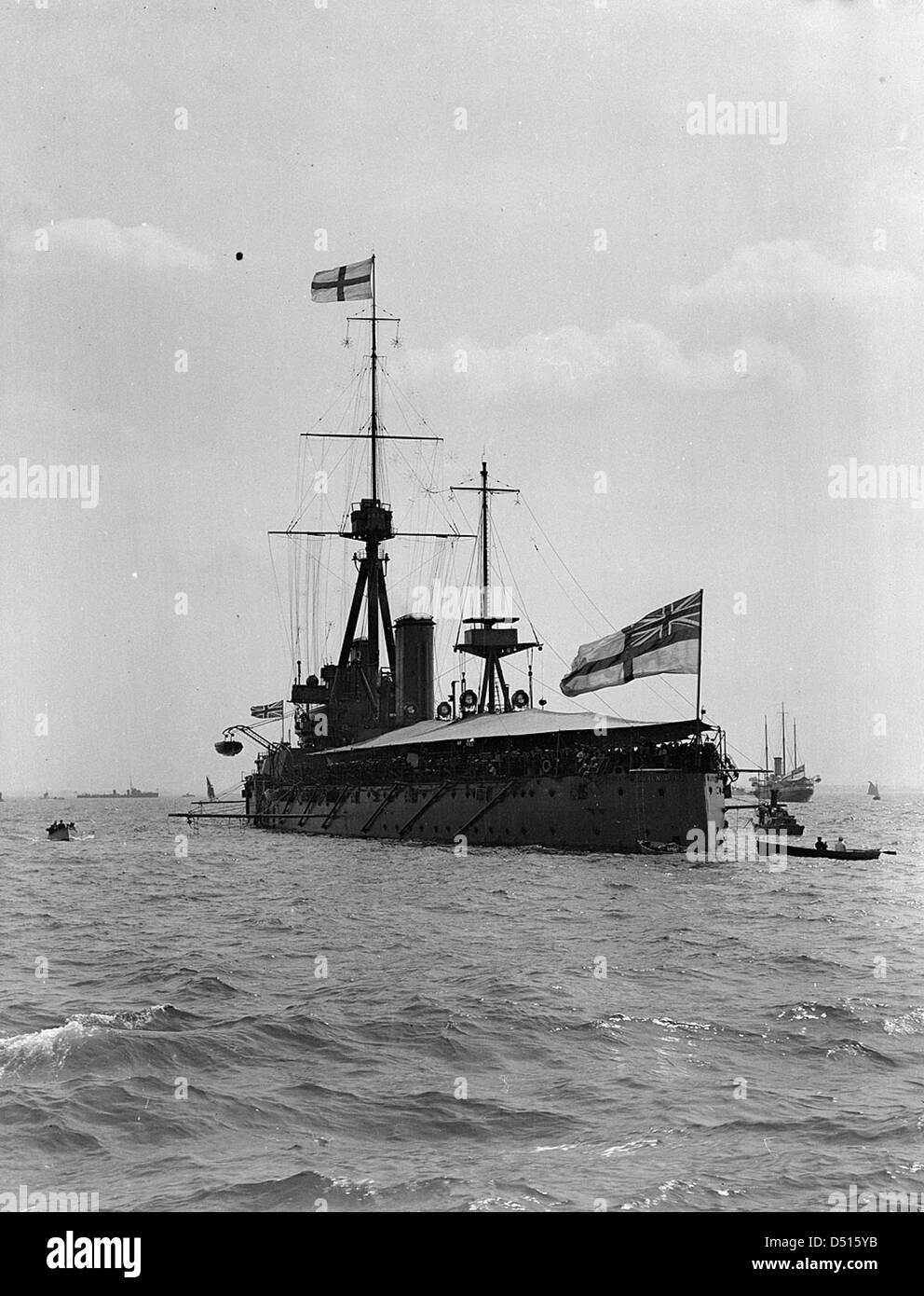 HMS 'Dreadnought' with awning rigged, anchored in the Thames Estuary - Stock Image