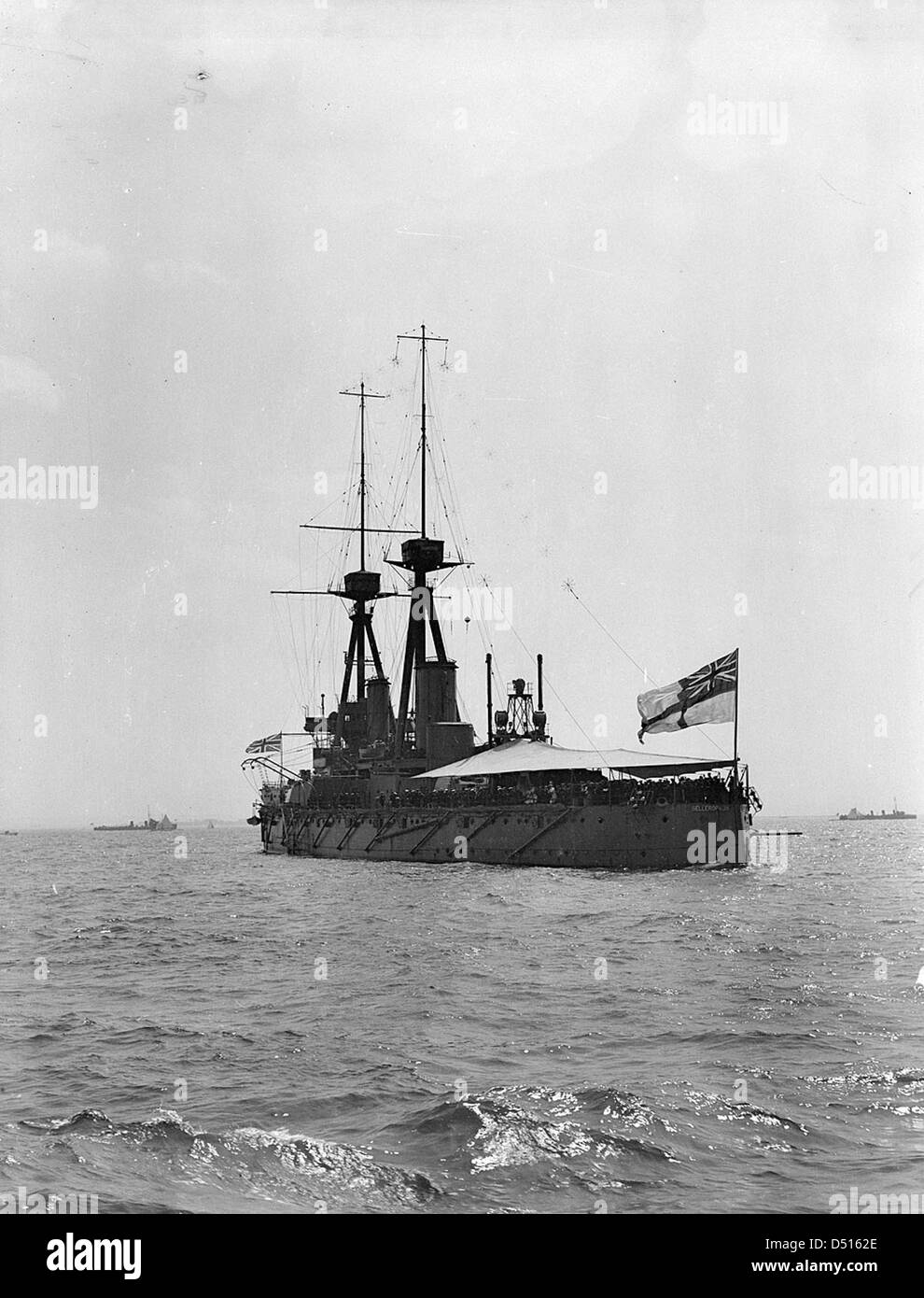 HMS 'Bellerophon' with awning rigged aft, anchored in the Thames Estuary - Stock Image