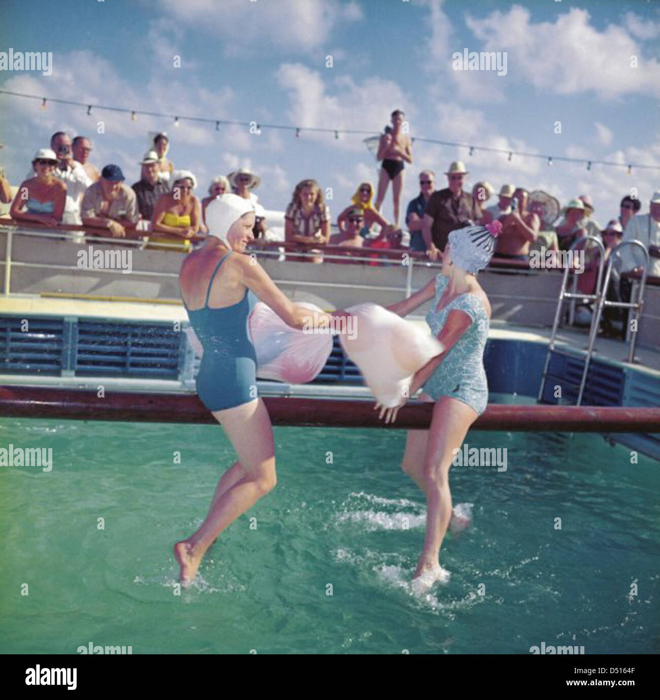 Two Ladies In Swimming Costumes In The Greasy Pole Competition