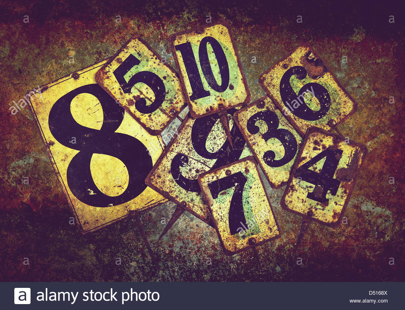 rusty tin plate numbers - Stock Image