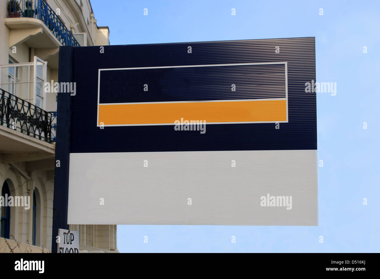 Blank for sale sign with copy space outside old house. - Stock Image