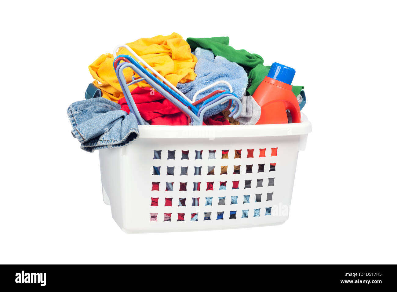 A laundry basket full of dirty clothing, clothes hangers and laundry detergent. Isolated on white for designer convenience. - Stock Image