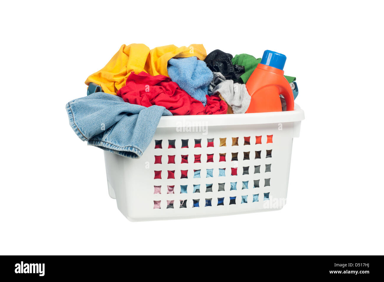 White laundry basket full of colorful clothing and a bottle of cleaning detergent. - Stock Image