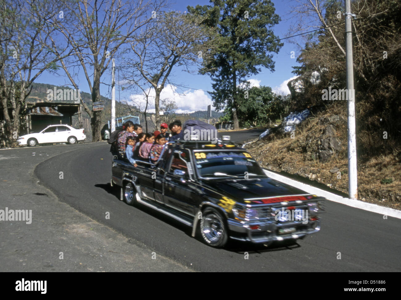 An overloaded taxi pickup in Santiago Atitlan - Stock Image