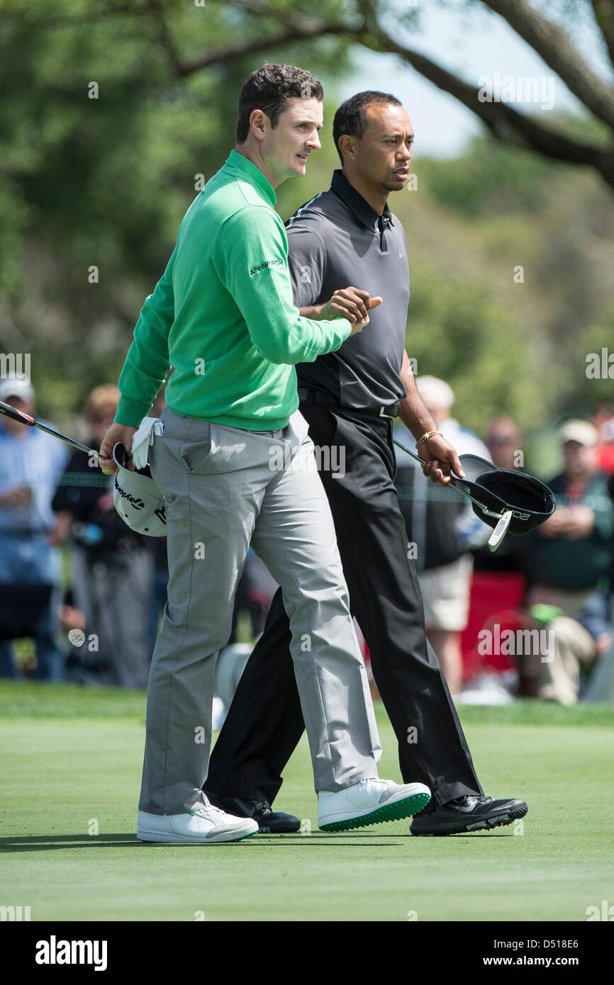 March 21, 2013: Justin Rose of England (L) shakes hands with Tiger Woods after first round golf action of the Arnold Palmer Invitational presented by ...
