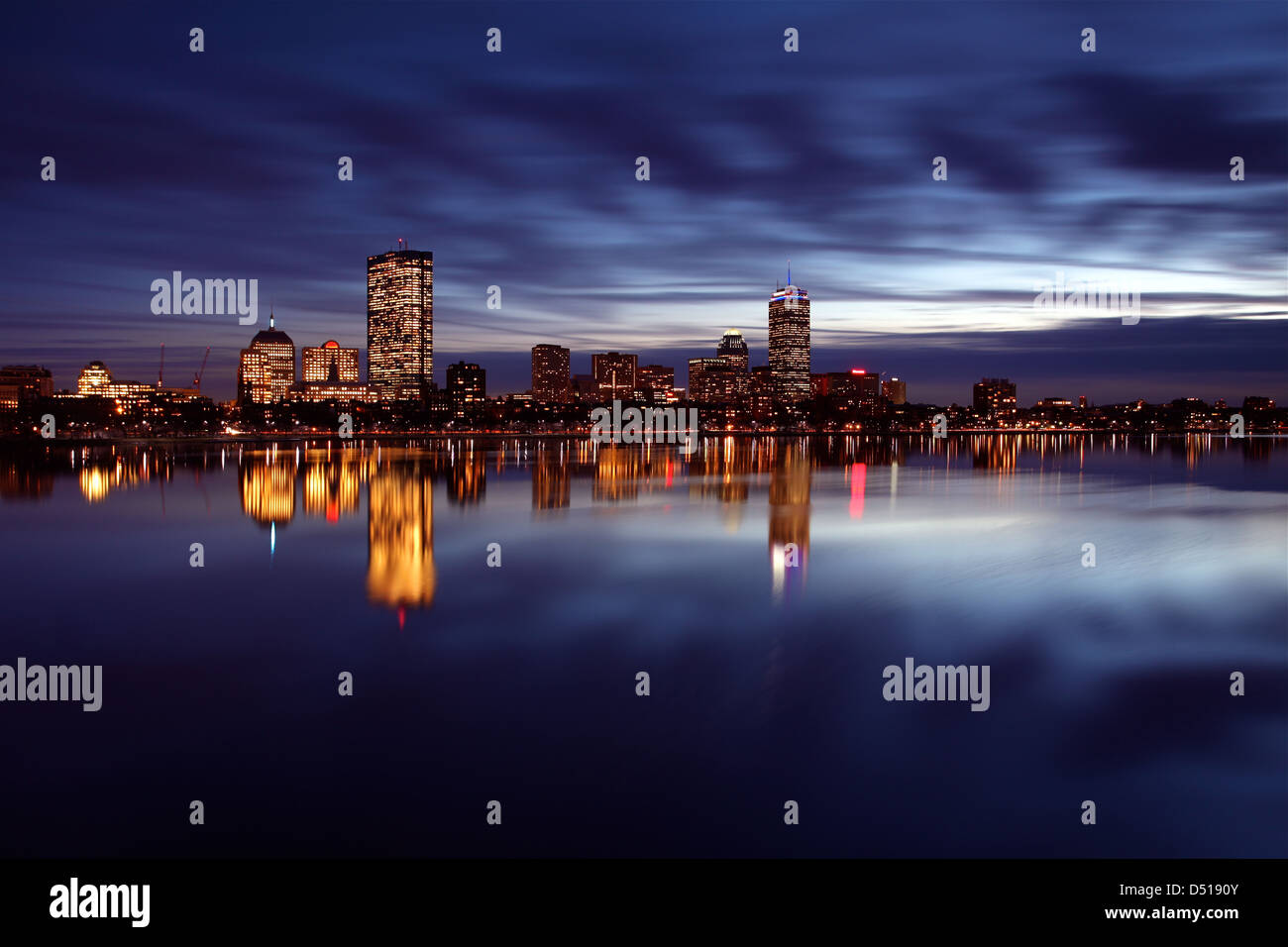 Boston's Back Bay skyline reflected in the Charles River with storm clouds Stock Photo