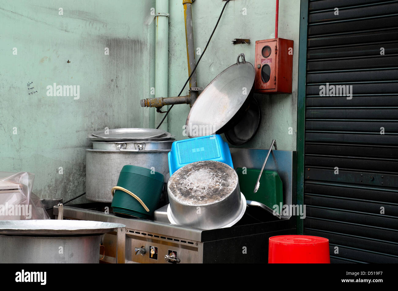 Clean pots and pans on outdoor sink - Stock Image