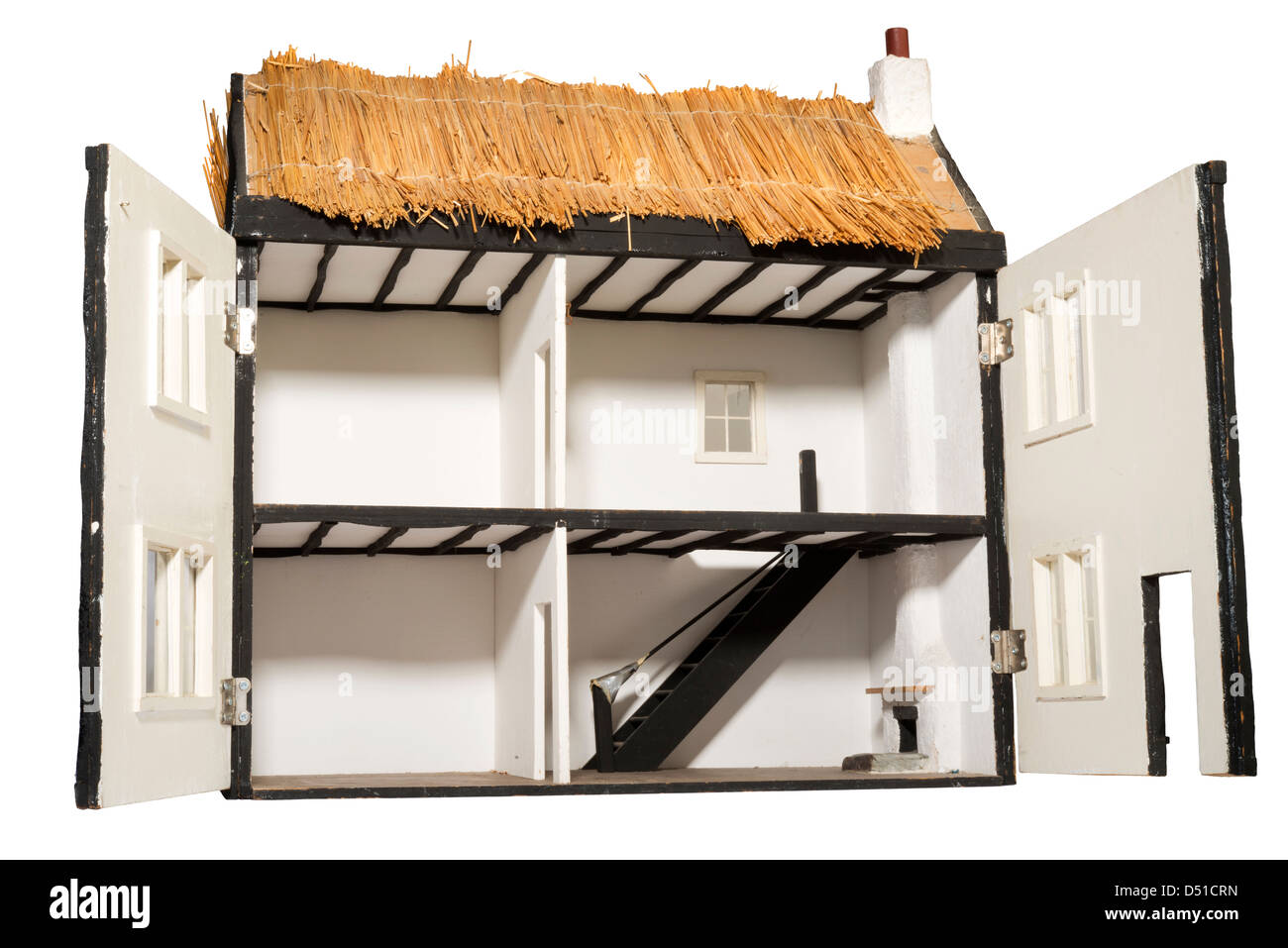 thatched roof dolls house - Stock Image