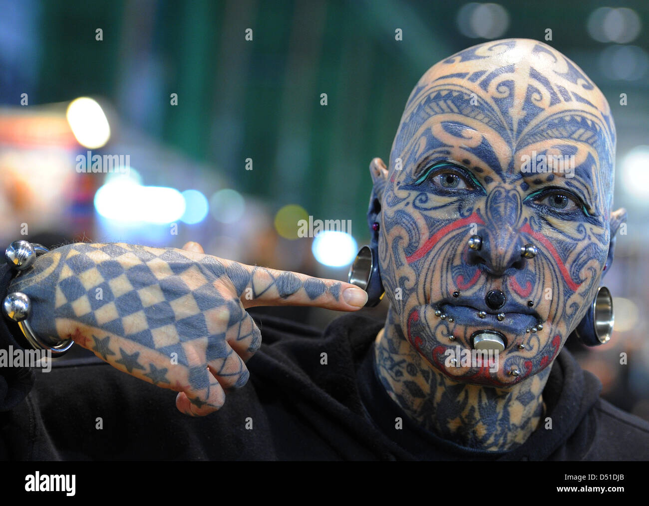Model Magneto poses during the 20th International Tattoo Convention ...