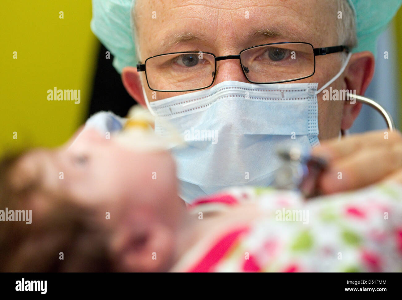 The director of children's cardiology, Dr Hans Gerd Kehl, examines a six-week-old baby in the intensive care - Stock Image