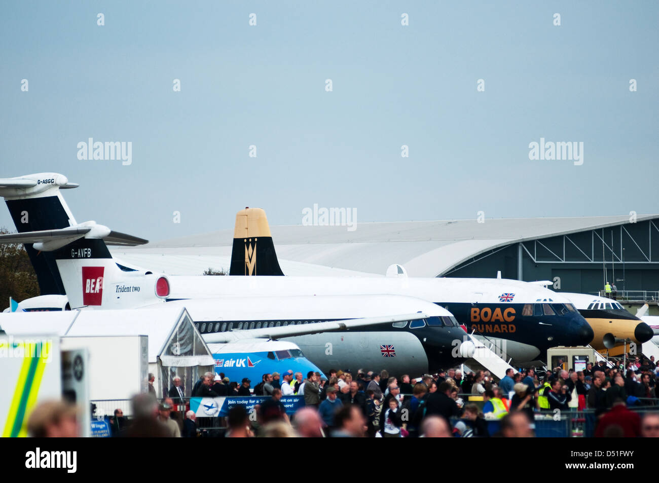 Landscape image showing large crowds of people and several aircraft at an air show in the UK. - Stock Image