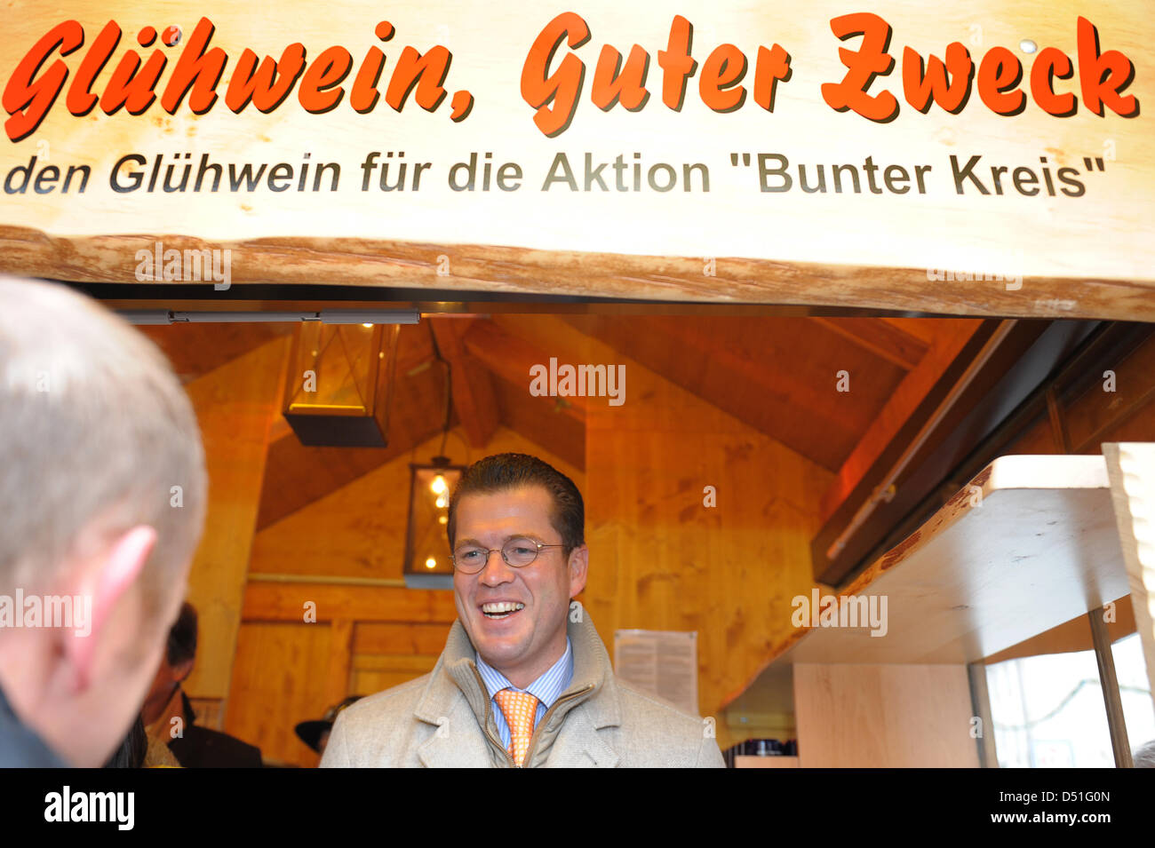 German Defence Minister Theodor zu Guttenberg sells mulled wine at the winter village in Bayreuth, Germany, 11 December - Stock Image