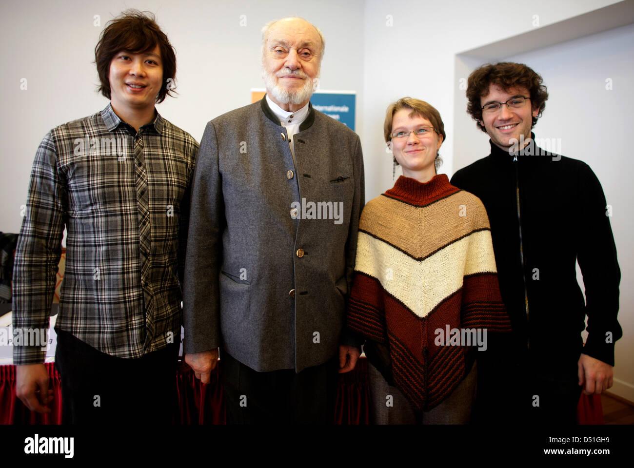 German maestro Kurt Masur (2-L)smiles with the three young conductors (L-R)Kang Ming Tan, Mirga Grazinyte - Stock Image