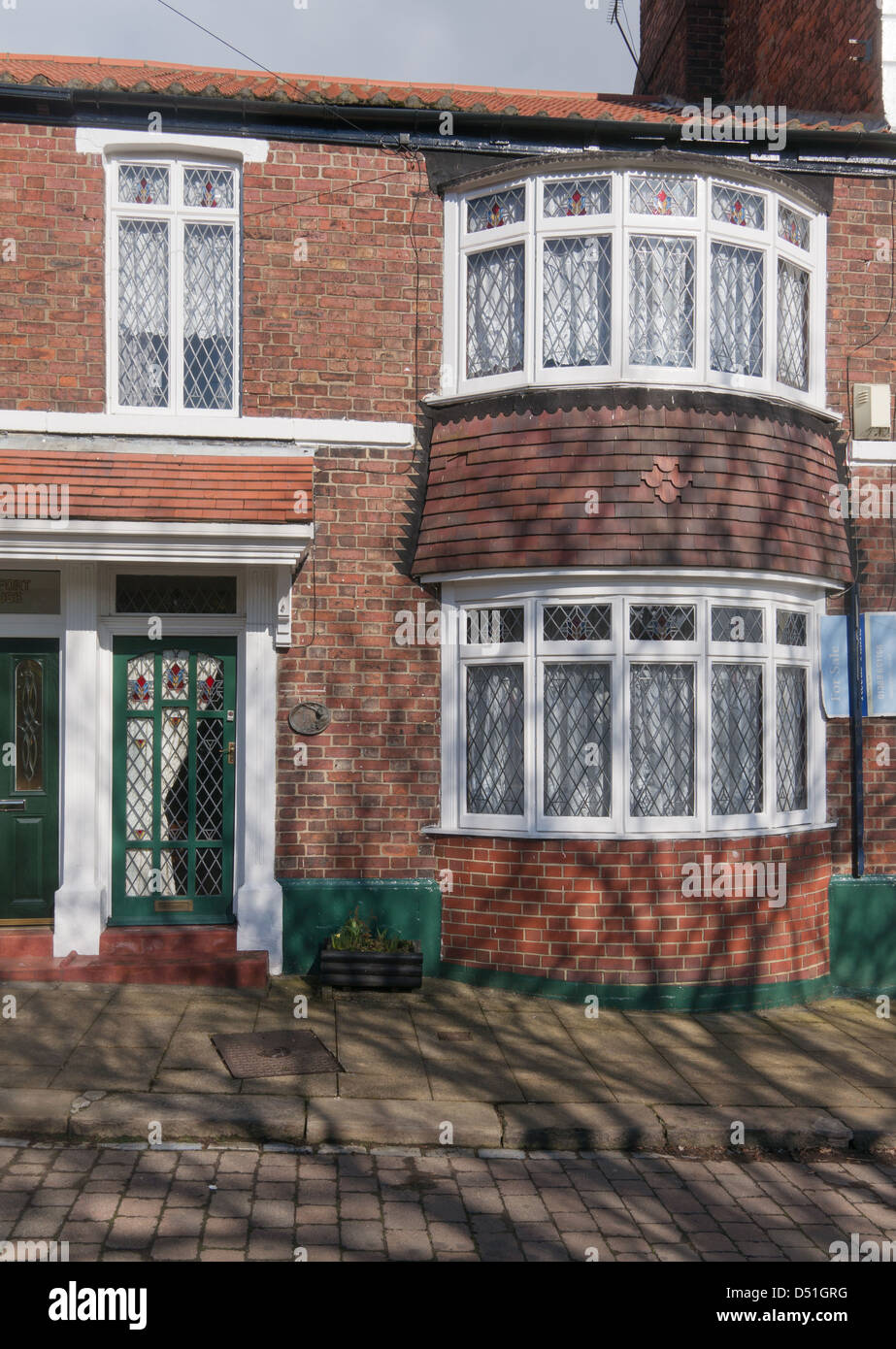 1930s style terraced house with leaded bay windows Bishop Auckland, north east England, UK - Stock Image