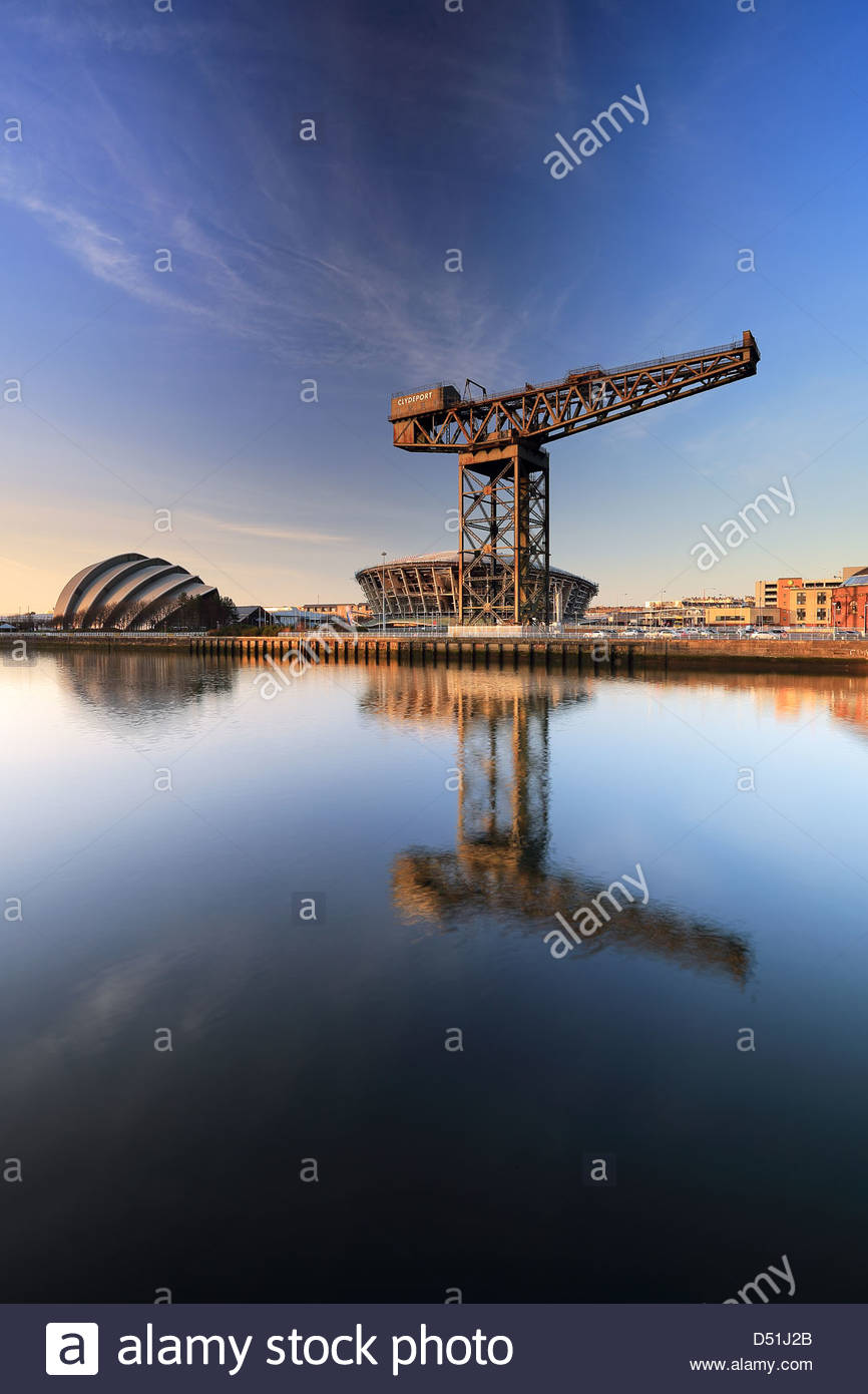 Glasgow Finnieston crane, Armadillo and the new Hydro centre reflecting on the River Clyde - Stock Image