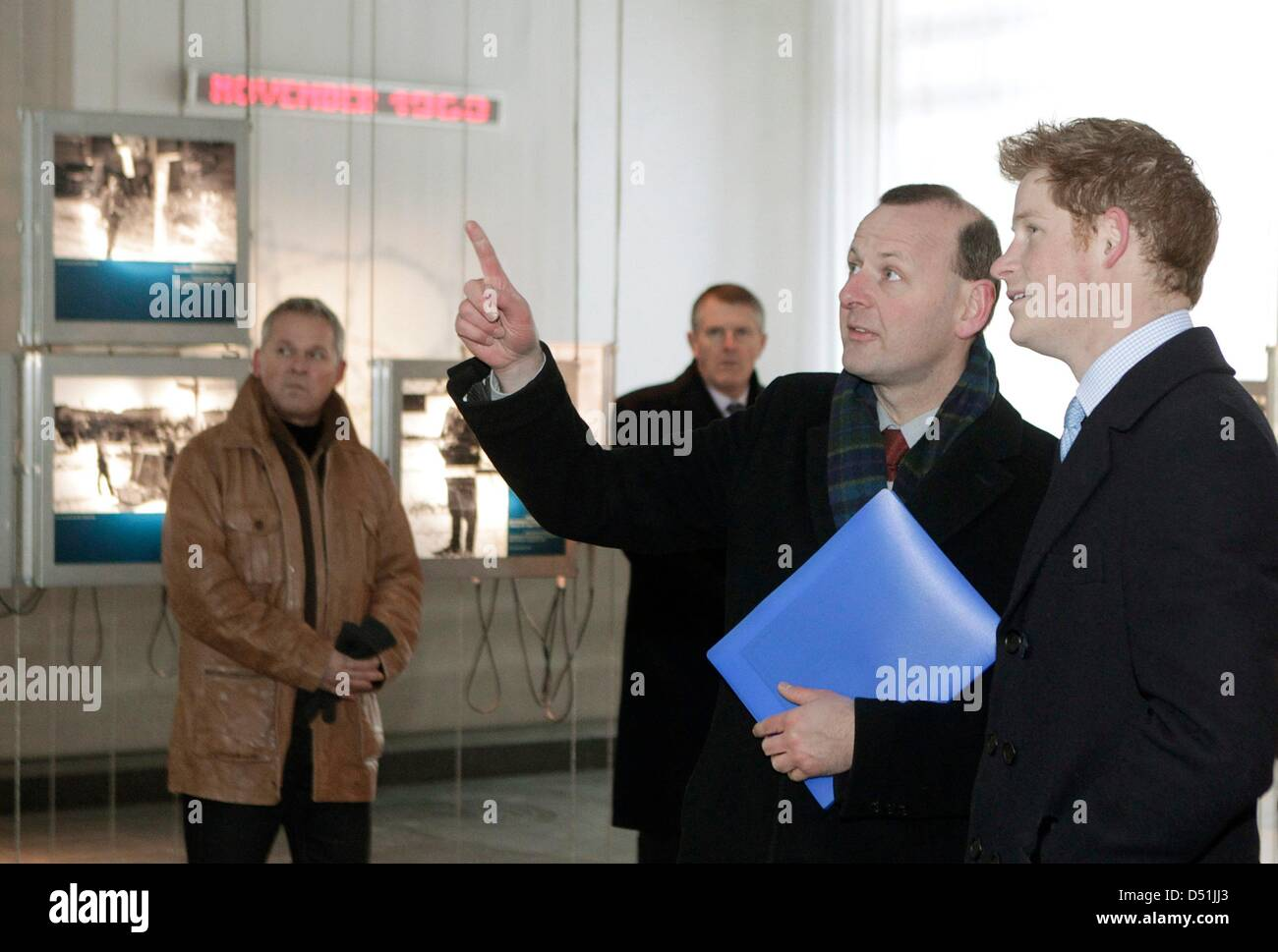 Britain's Prince Harry (R) listens to Axel Klausmeier, head of the Berlin Wall memorial fund, as he visits the documentation Stock Photo