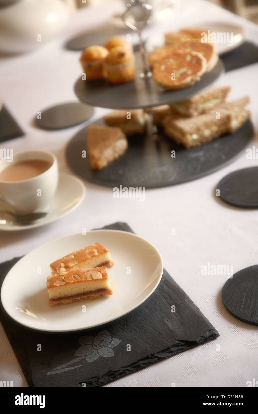 Afternoon tea table setting using welsh slate placemats and coasters in a home in south Wales, UK Stock Photo