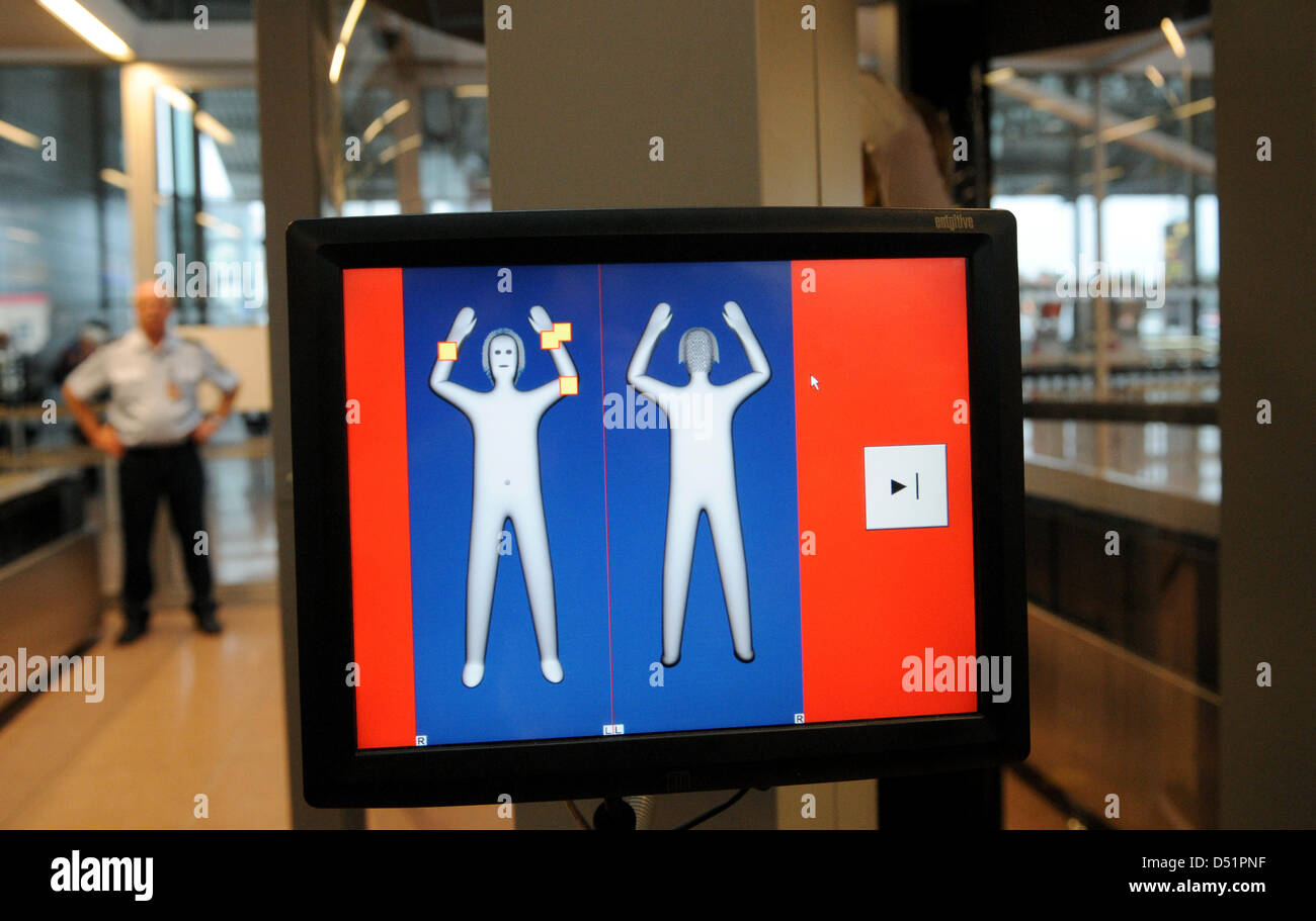 A womans stands inside a body scanner at the airport in Hamburg, Germany, 27 September 2010. Two such devices will - Stock Image