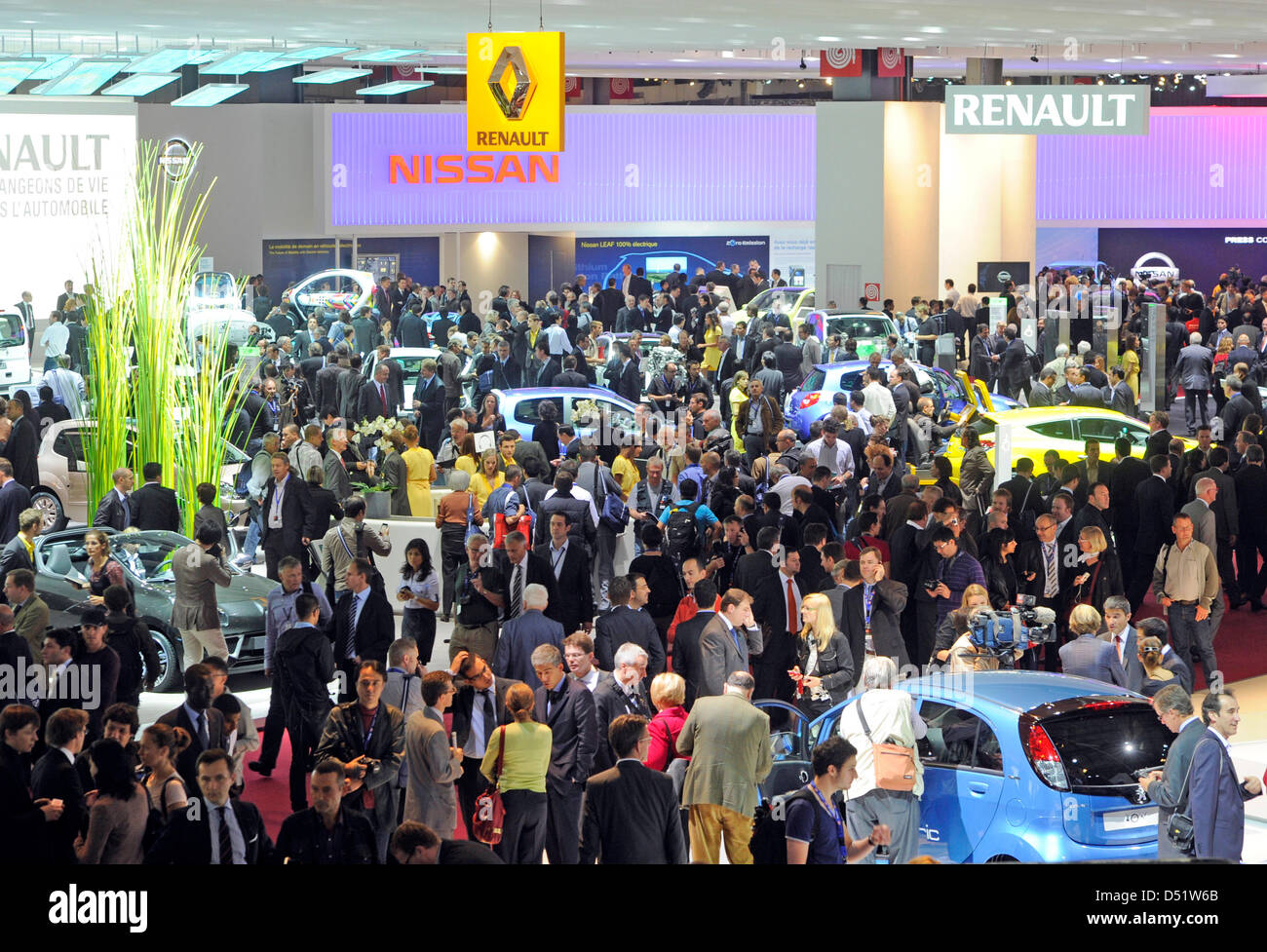 Visitors crowd at the booth of Renault during the 2010 Paris Motor Show in Paris, France, 30 September 2010. Some Stock Photo
