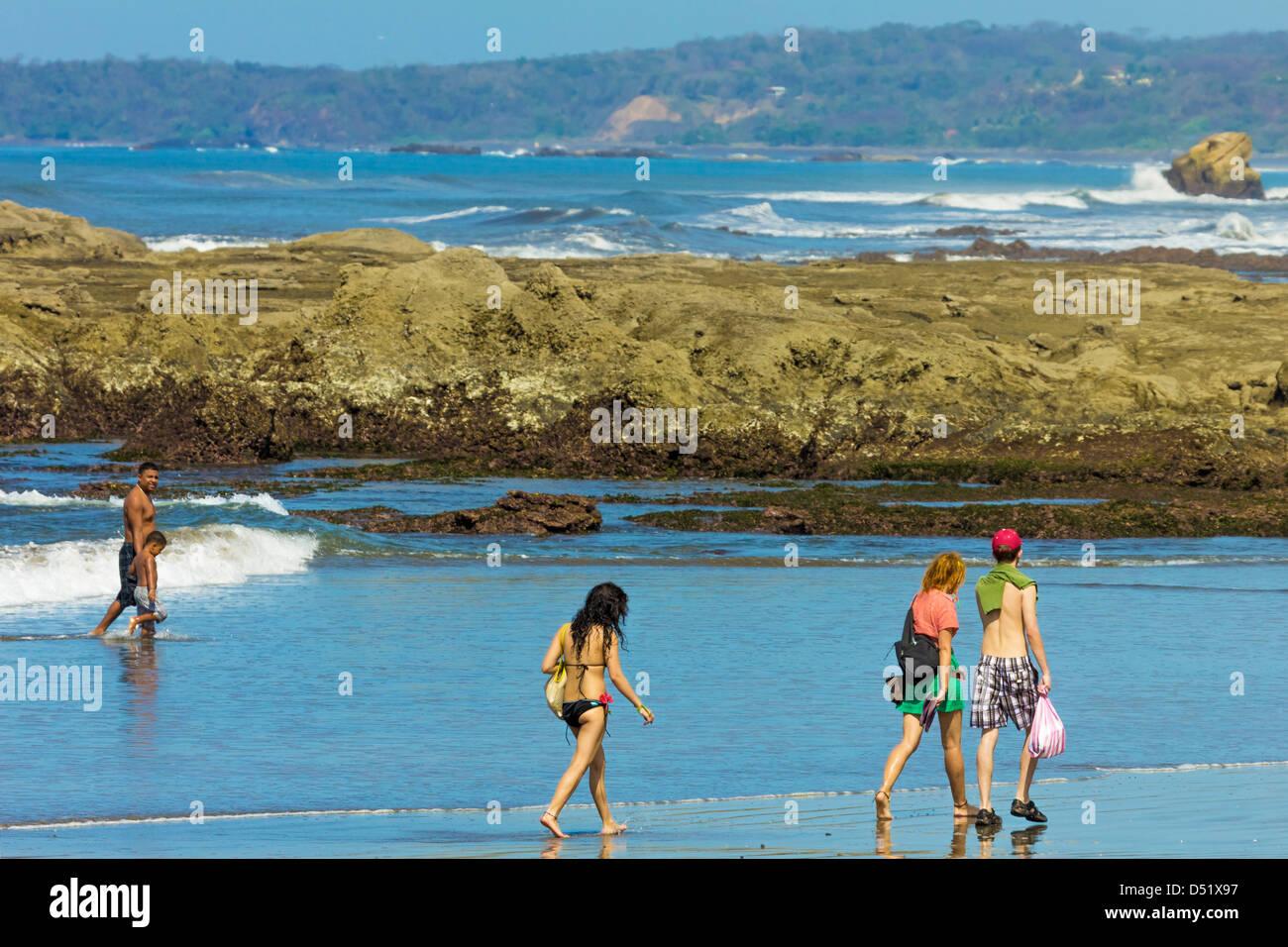 People Walking On Beautiful Playa Pelada Beach Nosara Nicoya Stock